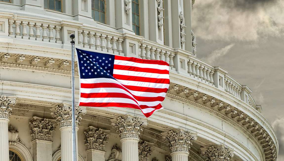 American flag in front of US Capital Building
