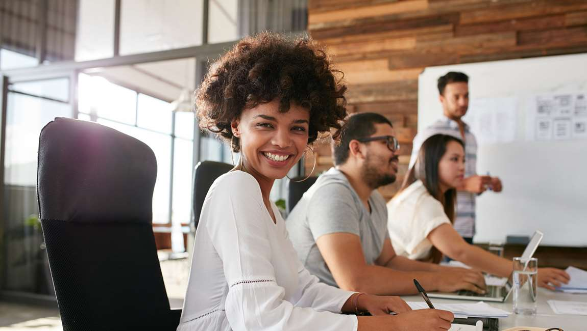 woman looking at camera in a meeting