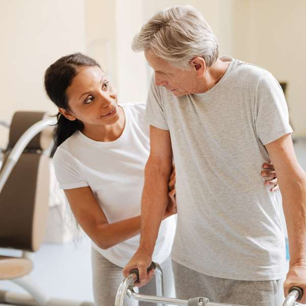 patient performing physical therapy with a nurse